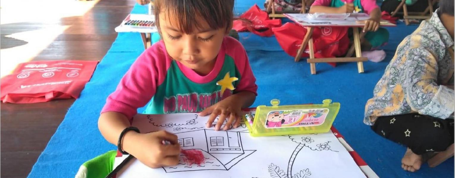 Little girl drawing a roof on her ideal house